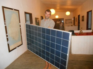 Installing solar panels at our eco center.